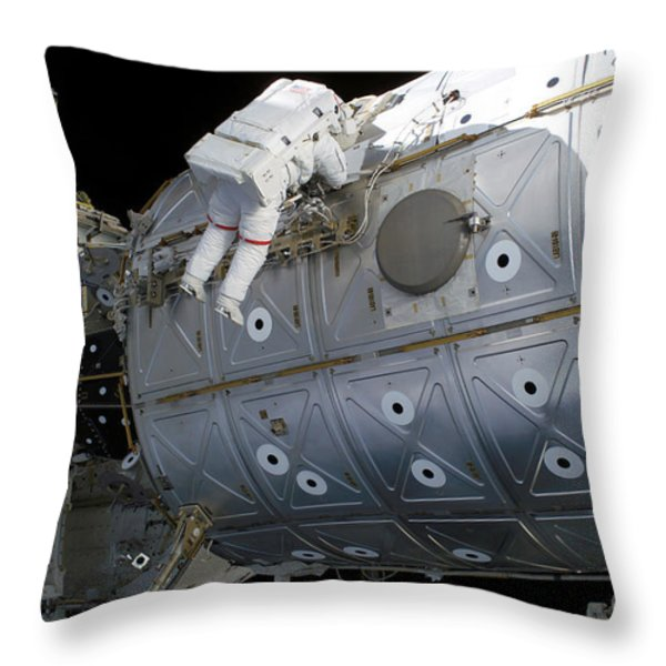 Astronaut Traverses Along The Destiny Throw Pillow by Stocktrek Images