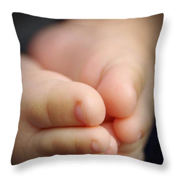 Baby feet Throw Pillow by Carlos Caetano