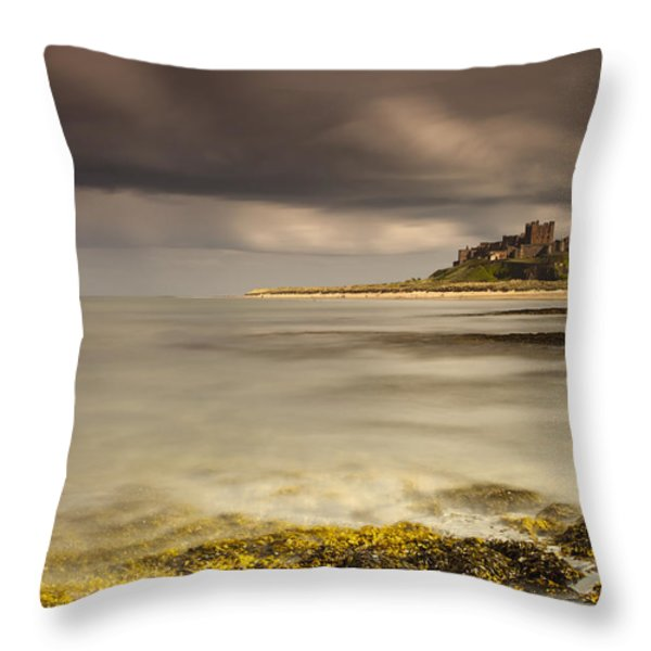 Bamburgh Castle Under A Cloudy Sky Throw Pillow by John Short