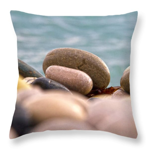 beach and stones Throw Pillow by Stylianos Kleanthous