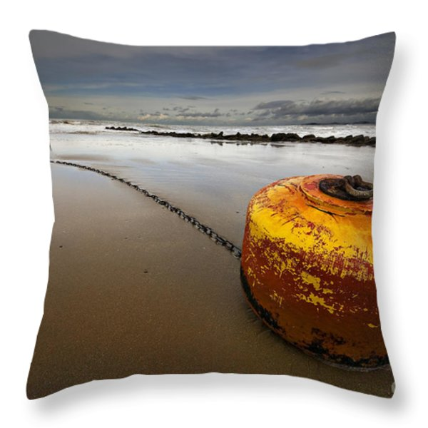 beached mooring buoy Throw Pillow by Meirion Matthias