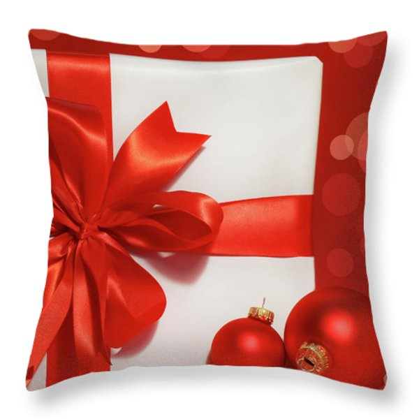 Big red bow on gift  Throw Pillow by Sandra Cunningham