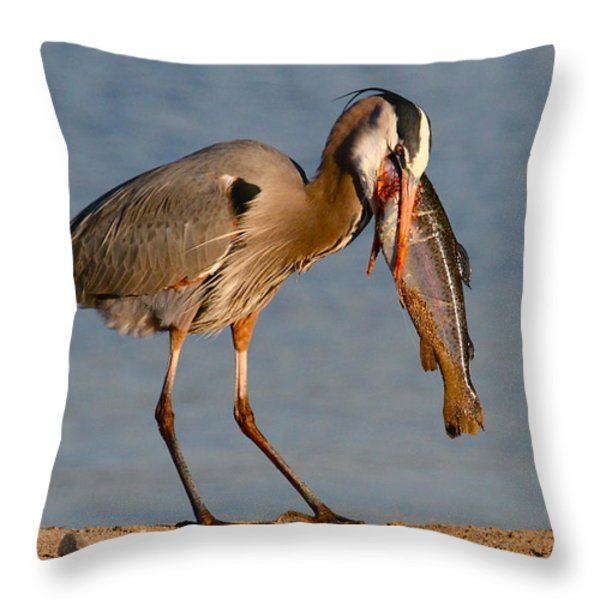 Blue Heron vs. Rainbow Trout Throw Pillow by Paul Marto