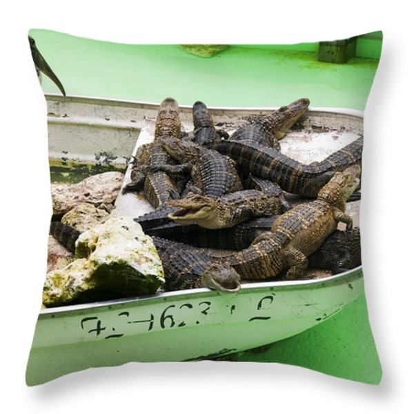 Boat full of alligators  Throw Pillow by Garry Gay