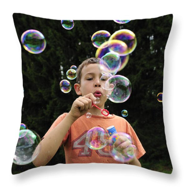 Boy with colorful bubbles Throw Pillow by Matthias Hauser