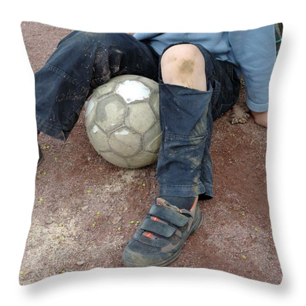 Boy With Soccer Ball Sitting On Dirty Field Throw Pillow by Matthias Hauser
