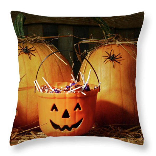 Bucket Filled With Halloween Candy Throw Pillow by Sandra Cunningham