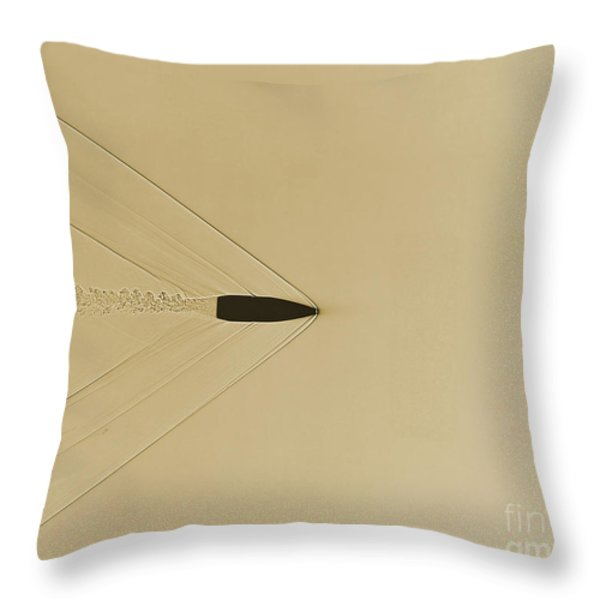 Bullet Through Air Throw Pillow by Omikron