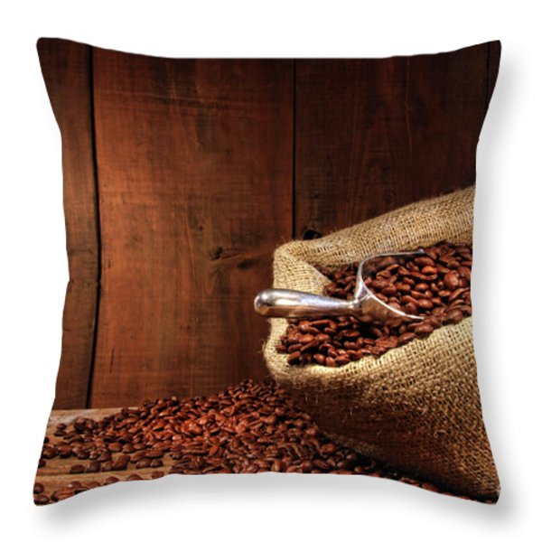 Burlap Sack Of Coffee Beans Against Dark Wood Throw Pillow by Sandra Cunningham