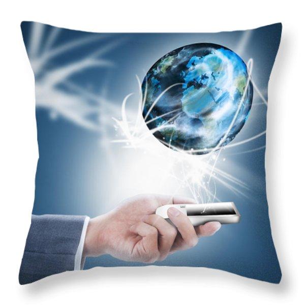 Businessman Holding Mobile Phone With Globe Throw Pillow by Setsiri Silapasuwanchai