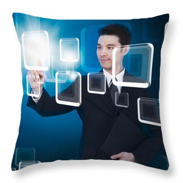 Businessman Pressing Touchscreen Throw Pillow by Setsiri Silapasuwanchai