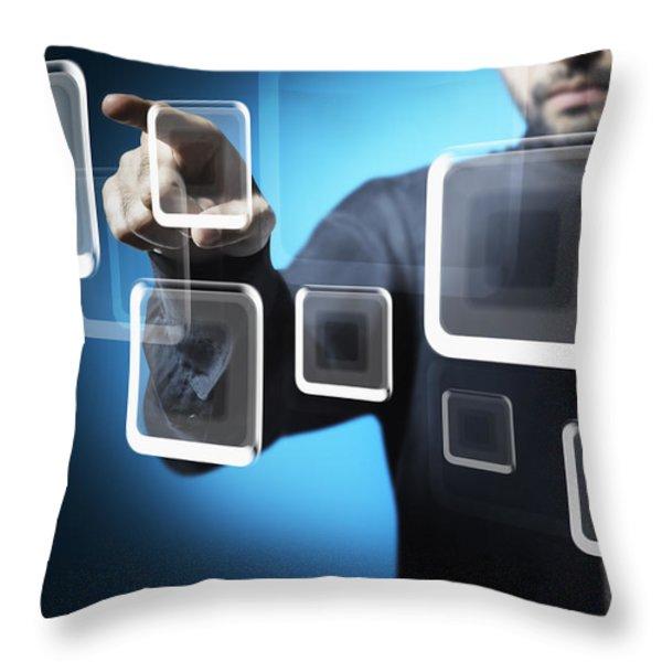 Businessman touching screen button Throw Pillow by Setsiri Silapasuwanchai