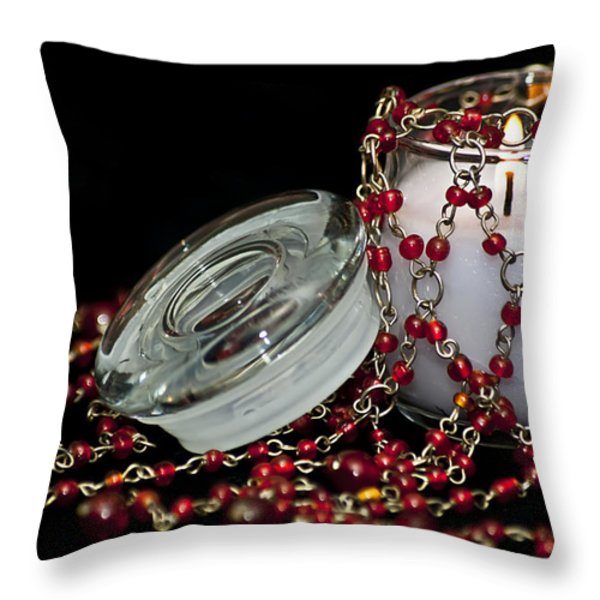 Candle and Beads Throw Pillow by Carolyn Marshall