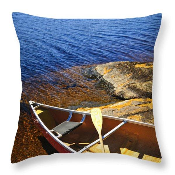 Canoe On Shore Throw Pillow by Elena Elisseeva