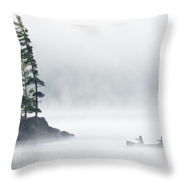 Canoeing Through Fog On Lake Of Two Throw Pillow by Mike Grandmailson