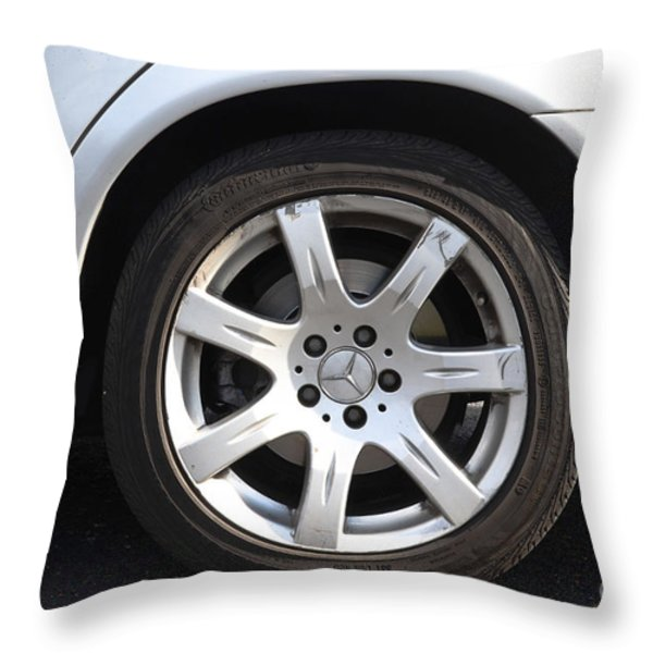 Car Wheel Throw Pillow by Photo Researchers