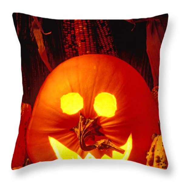 Carved Pumpkin With Fall Leaves Throw Pillow by Garry Gay