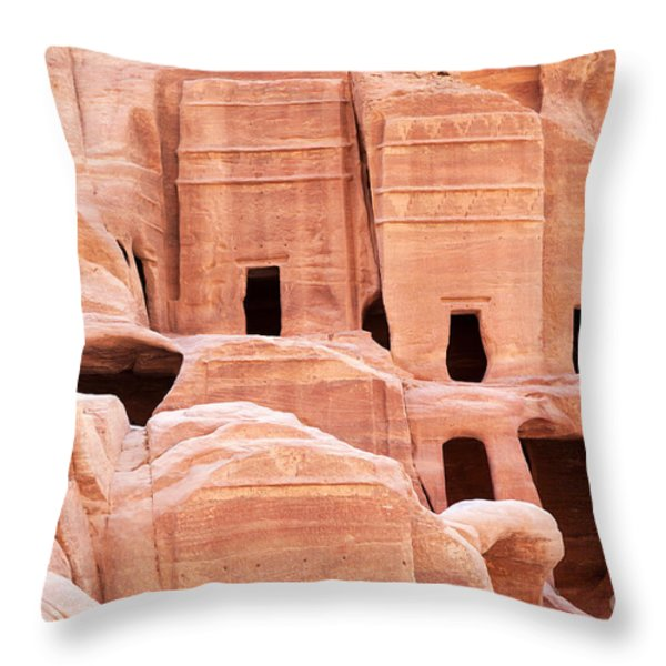 Cave dwellings Petra. Throw Pillow by Jane Rix