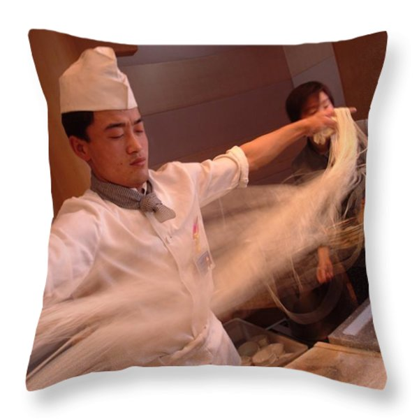 Chef Stretches Dough As He Makes Fresh Throw Pillow by Richard Nowitz