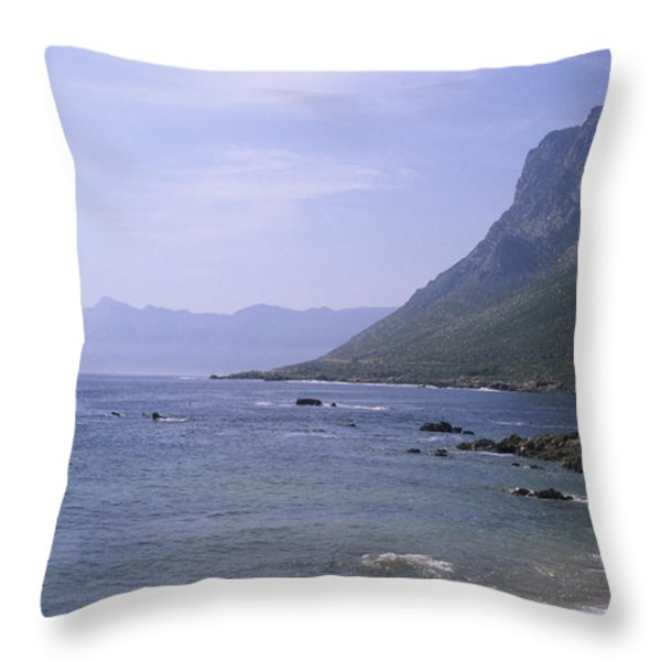 Cliffs Rise From The Ocean Near Cape Throw Pillow by Stacy Gold