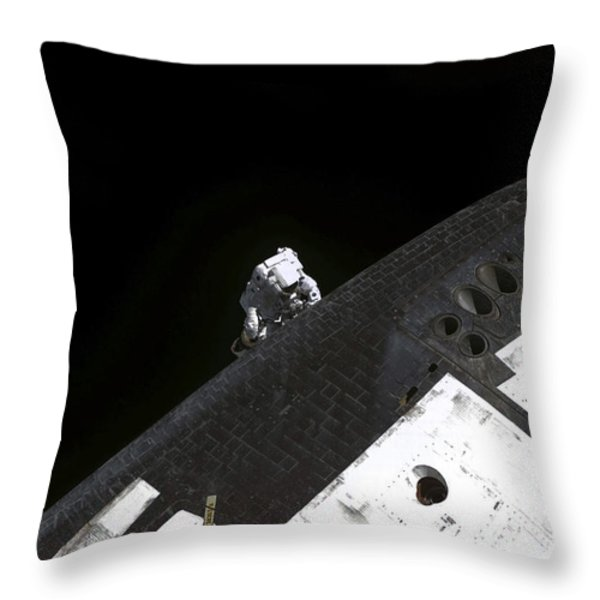 Close-up View Of The Nose Cone On Space Throw Pillow by Stocktrek Images