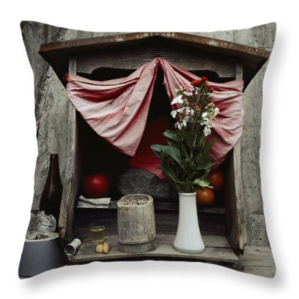 Close View Of A Shrine With Oferings Throw Pillow by Sam Abell