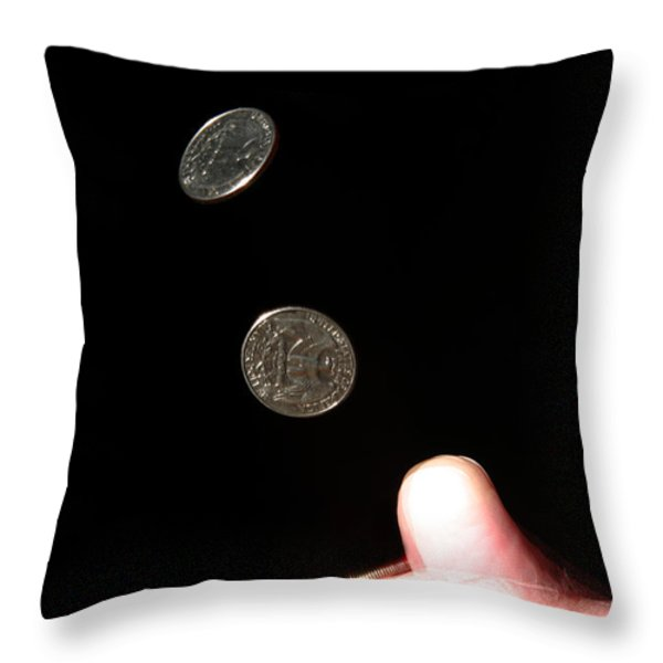 Coin Flipping Throw Pillow by Ted Kinsman