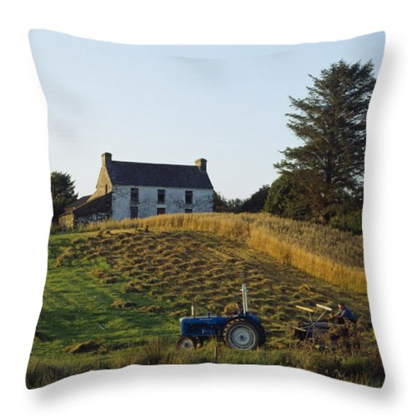 County Cork, Ireland Farmer On Tractor Throw Pillow by Ken Welsh