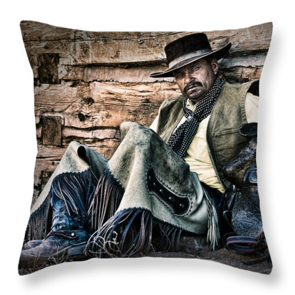 Cowboy Stare-Down Throw Pillow by Janet Fikar