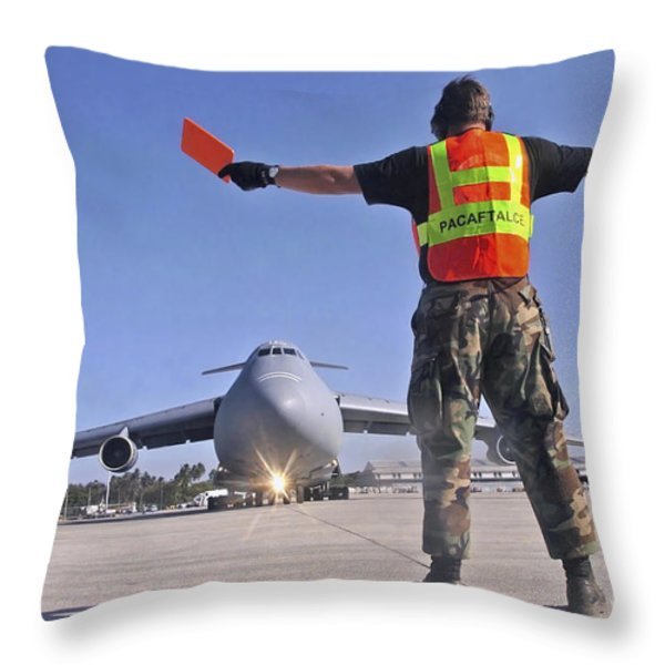 Crew Chief Marshals A C-5 Galaxy Throw Pillow by Stocktrek Images