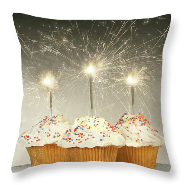 Cupcakes with sparklers Throw Pillow by Sandra Cunningham