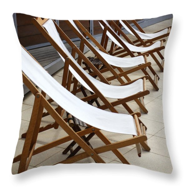 Deckchairs Throw Pillow by Carlos Caetano