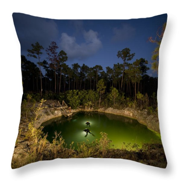 Divers Surface After Collecting Throw Pillow by Wes C. Skiles