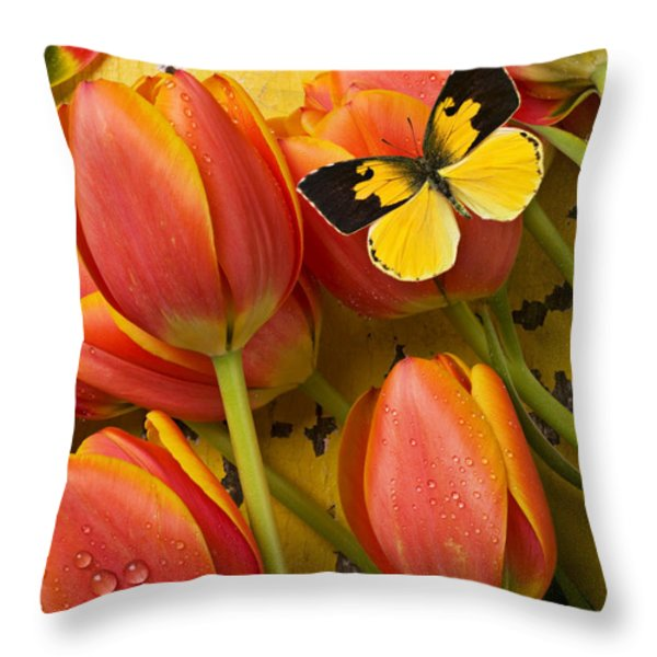 Dogface butterfly and tulips Throw Pillow by Garry Gay