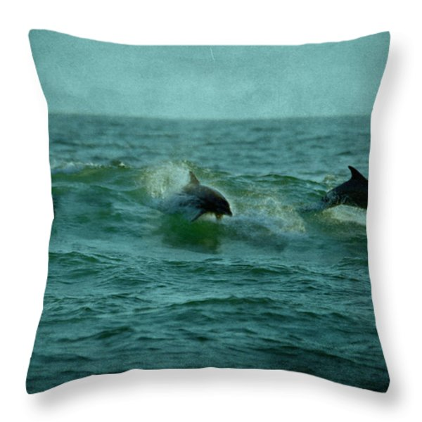 Dolphins Throw Pillow by Sandy Keeton
