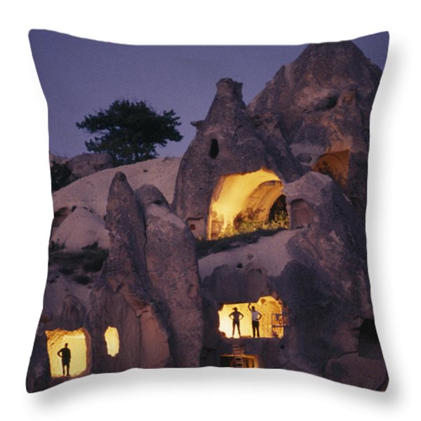 Figures Stand In The Doorways Throw Pillow by Jonathan Blair