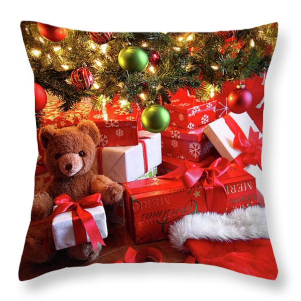 Gifts under the tree for Christmas Throw Pillow by Sandra Cunningham