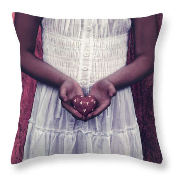 girl with a heart Throw Pillow by Joana Kruse