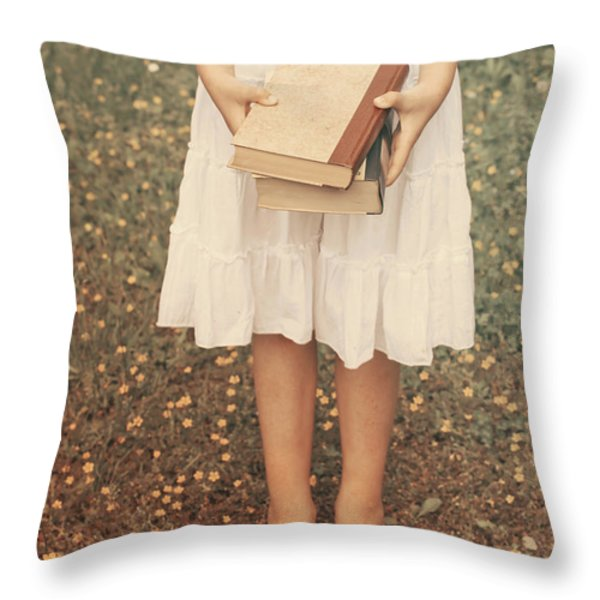 Girl With Old Books Throw Pillow by Joana Kruse