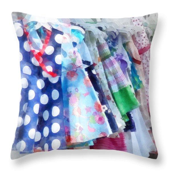 Girl's Dresses At Street Fair Throw Pillow by Susan Savad