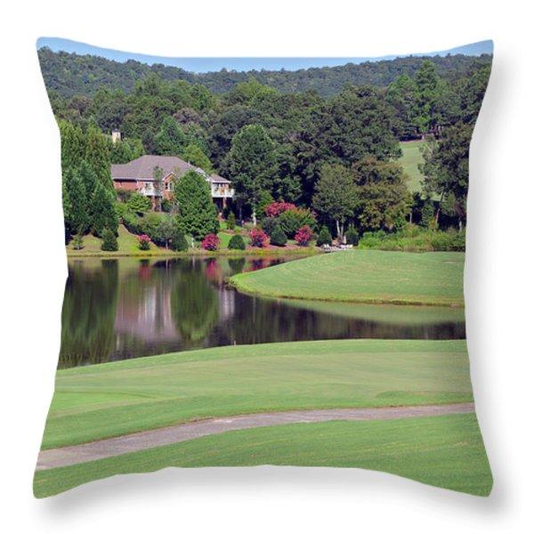 Golfer At Lake  Throw Pillow by Susan Leggett