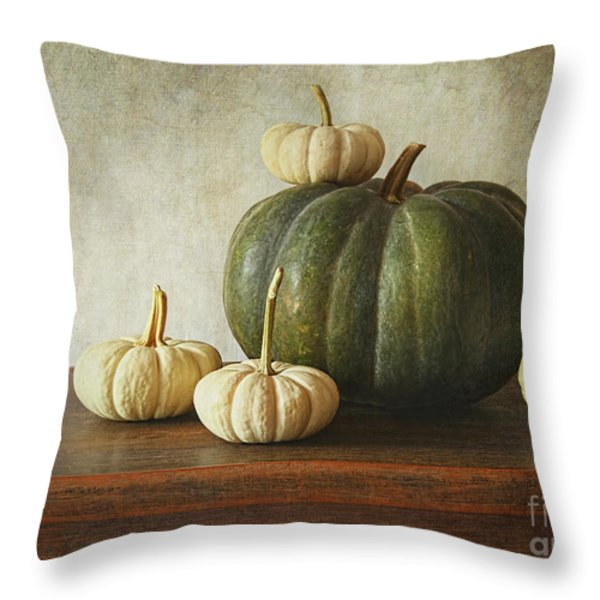 Green Pumpkin And Gourds On Table Throw Pillow by Sandra Cunningham