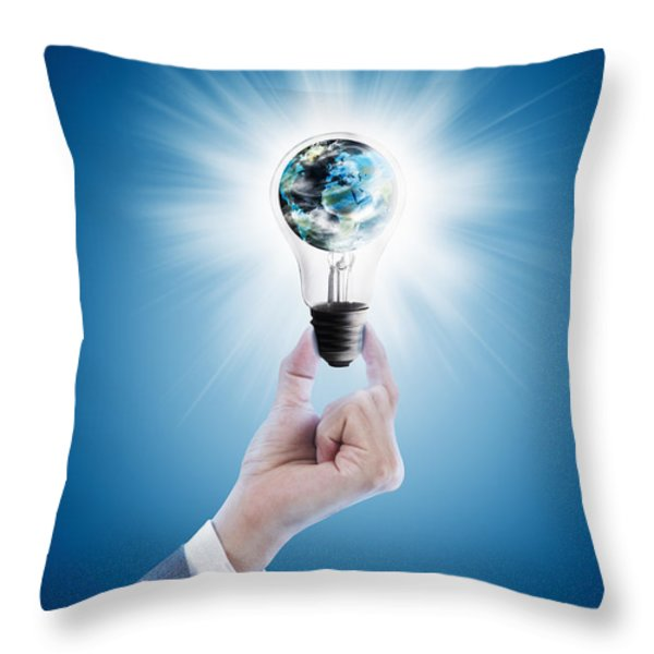 Hand holding light bulb with globe  Throw Pillow by Setsiri Silapasuwanchai