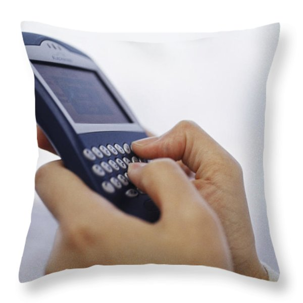 Hands Hold And Key Into A Blackberry Throw Pillow by Justin Guariglia