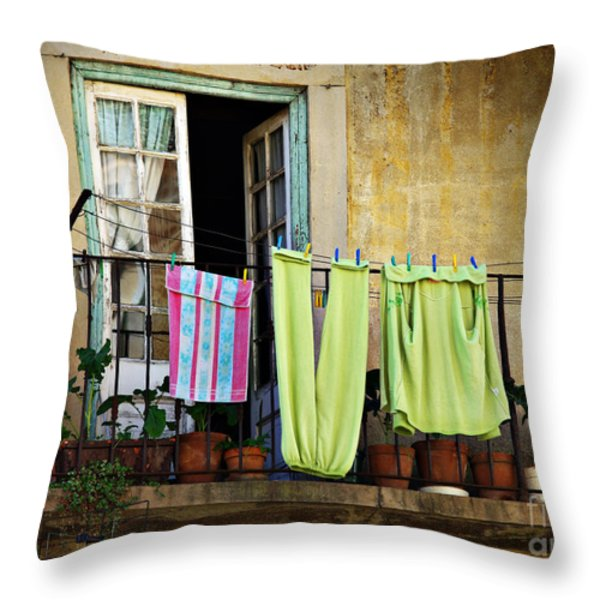 Hanged Clothes Throw Pillow by Carlos Caetano
