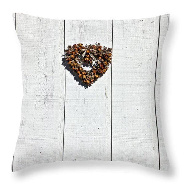Heart wreath on wood wall Throw Pillow by Garry Gay