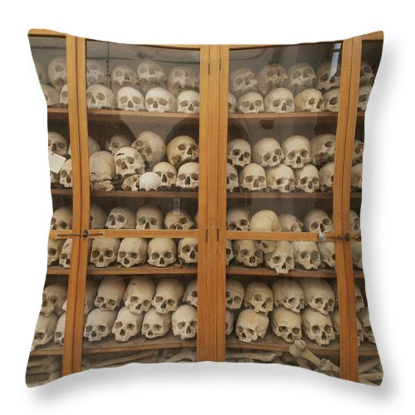 Human Skulls And Femurs Fill A Display Throw Pillow by Tino Soriano