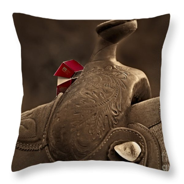 In The Saddle Throw Pillow by Susan Candelario