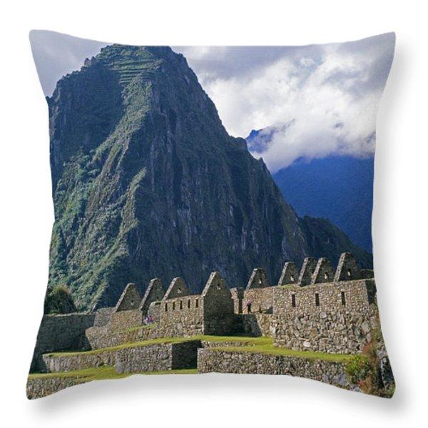 Inca Structures Stand Below Mount Throw Pillow by Gordon Wiltsie