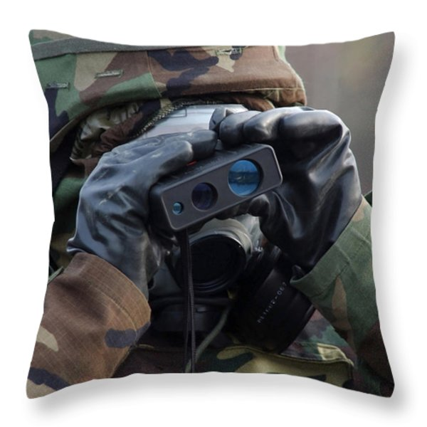 Irman Uses A Range Finder To Determine Throw Pillow by Stocktrek Images